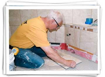 carey construction worker installing tile
