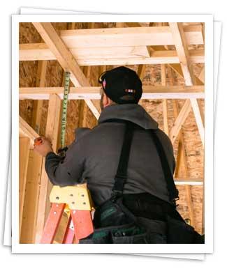 carey construction worker measuring frame